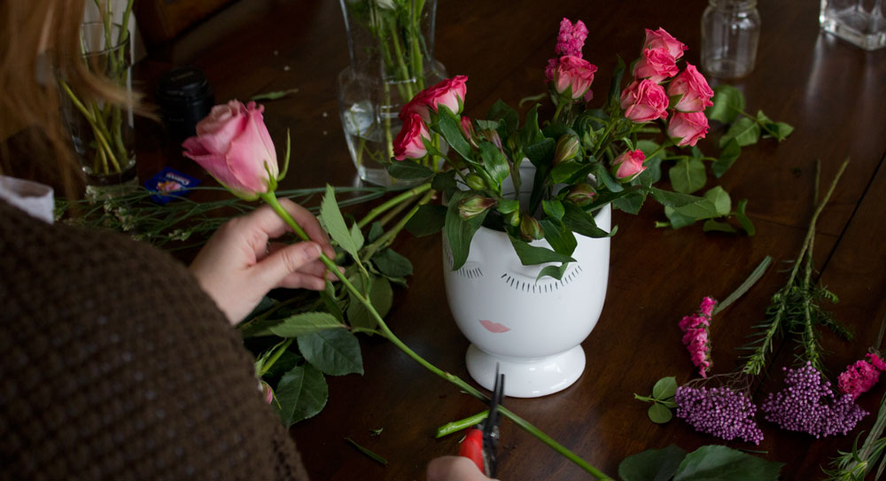 Adding roses to the arrangement