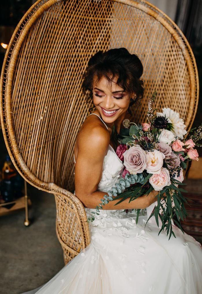 Happy bride with moody bridal bouquet