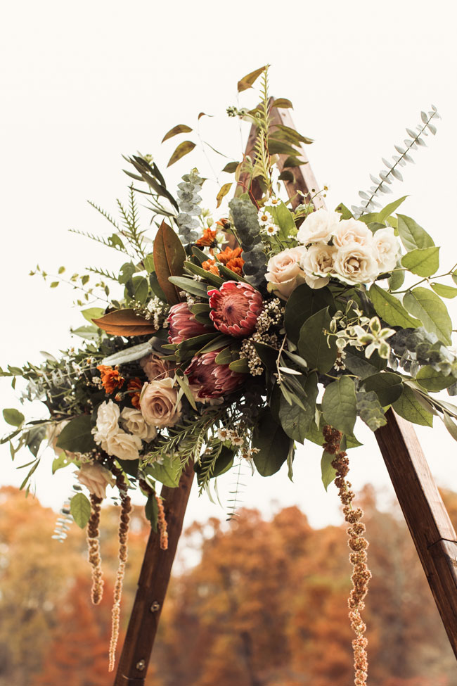 Floral arrangement attached to a triangle arbor