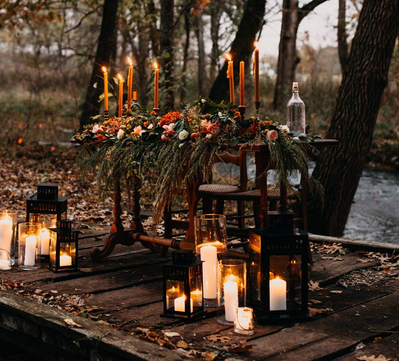 Sweetheart table loaded with fall flowers