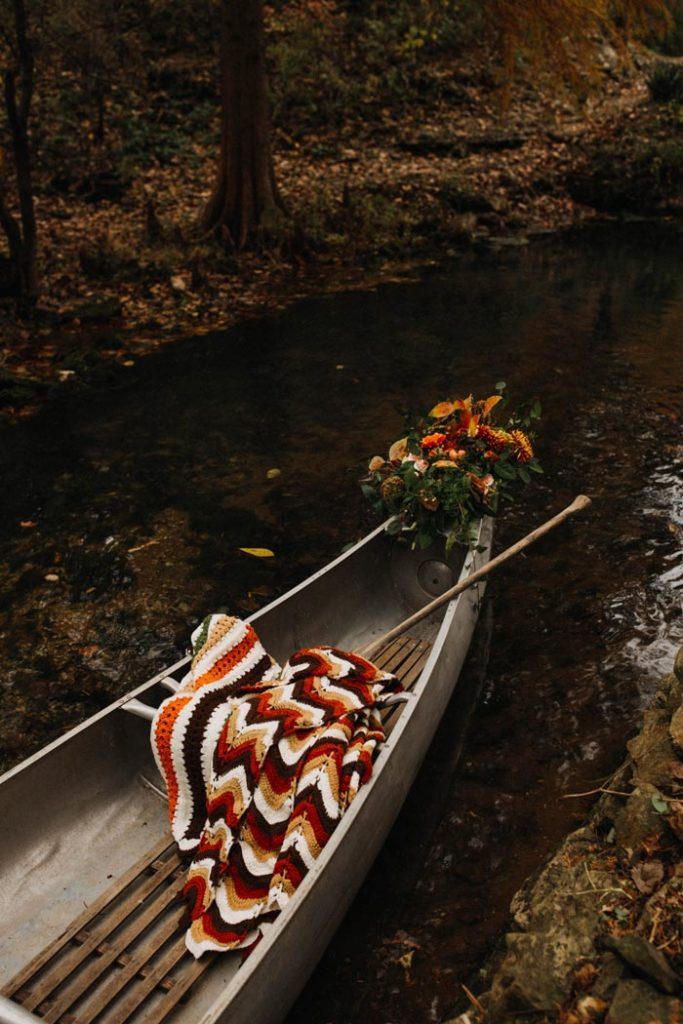 Cozy Canoe With Floral Masthead