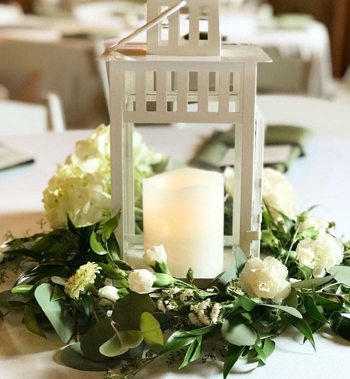 Floral Wreath Around White Lantern