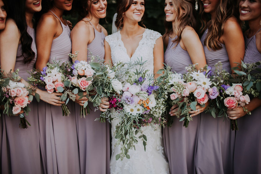 Bride with seven bridesmaids holding bouquets
