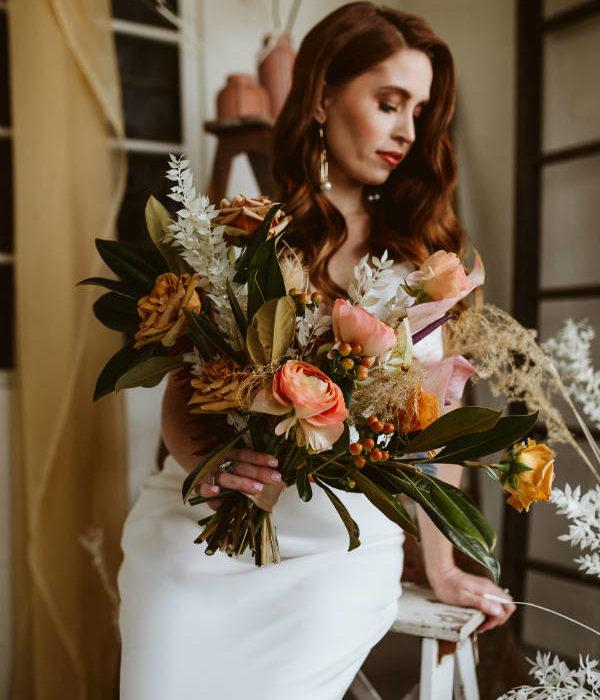 Bride Holding Salmon Bridal Bouquet