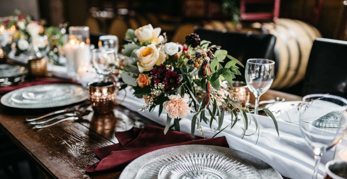Family-style reception table with floral centerpieces