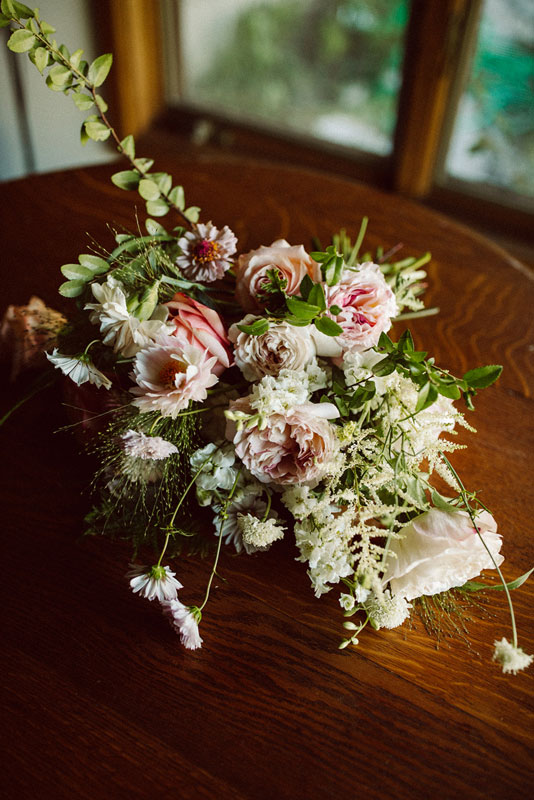 Blush bridal bouquet laying on a table