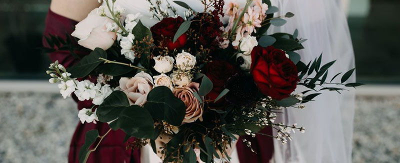 Bridal bouquet in burgundies and dusty rose