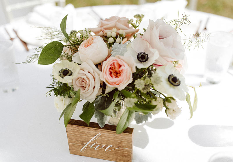 Peach and white centerpiece featuring anemone