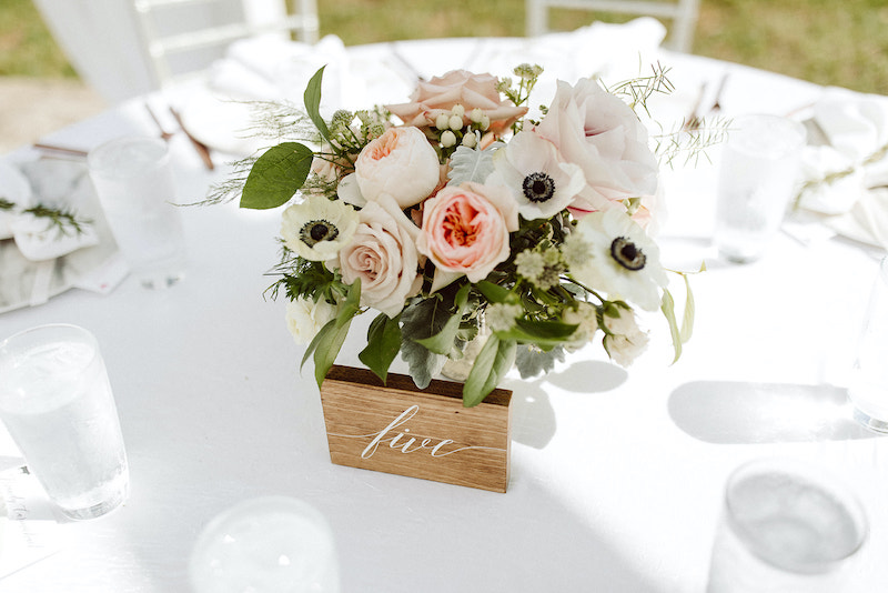 Round floral centerpiece with roses and anemone