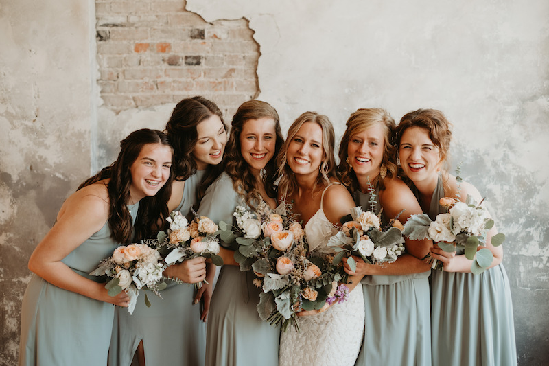 Bridal party holding bouquets