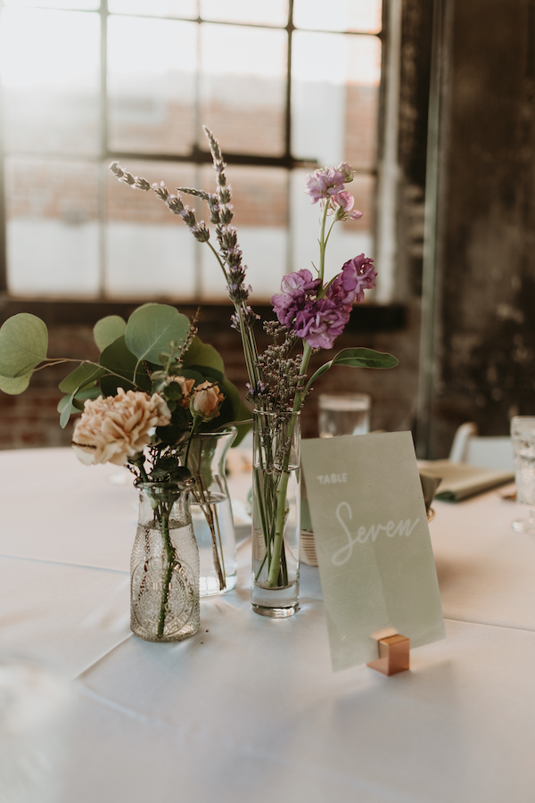 Peach and lavender bud vases on guest table