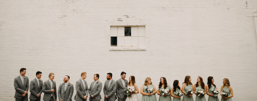 Groomsmen and bridesmaids together for a spring wedding at Stone Chapel