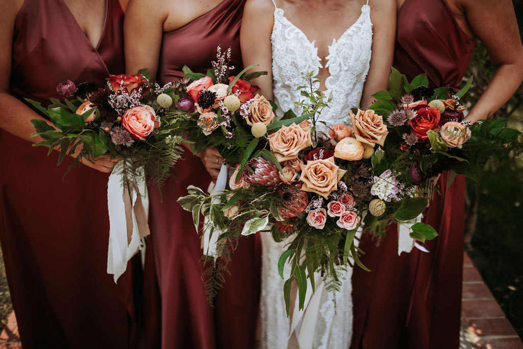 Bride and maids holding bouquets