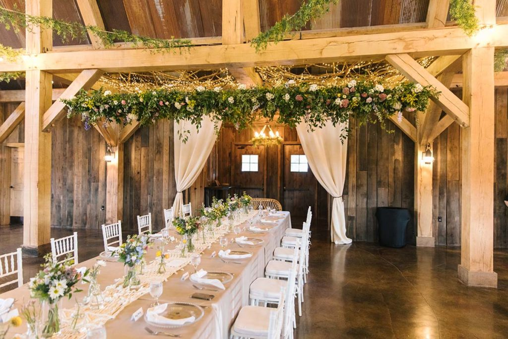 Set head table with hanging floral installation overhead