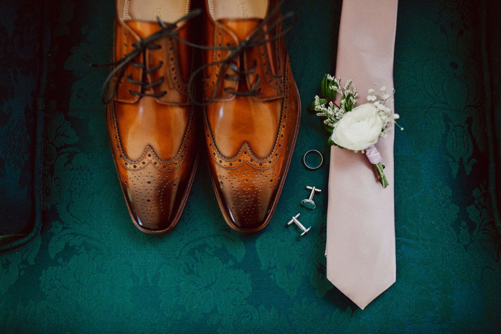 Leather shoes, cuff links, boutonniere and tie