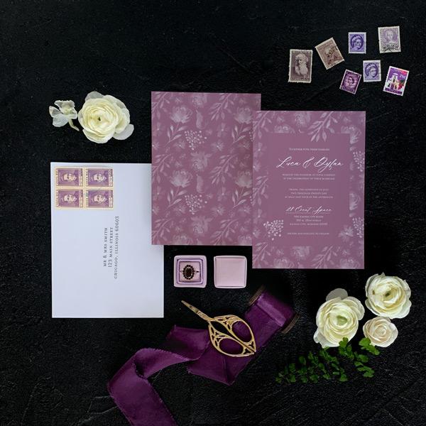 Mauve wedding invitation with white envelope