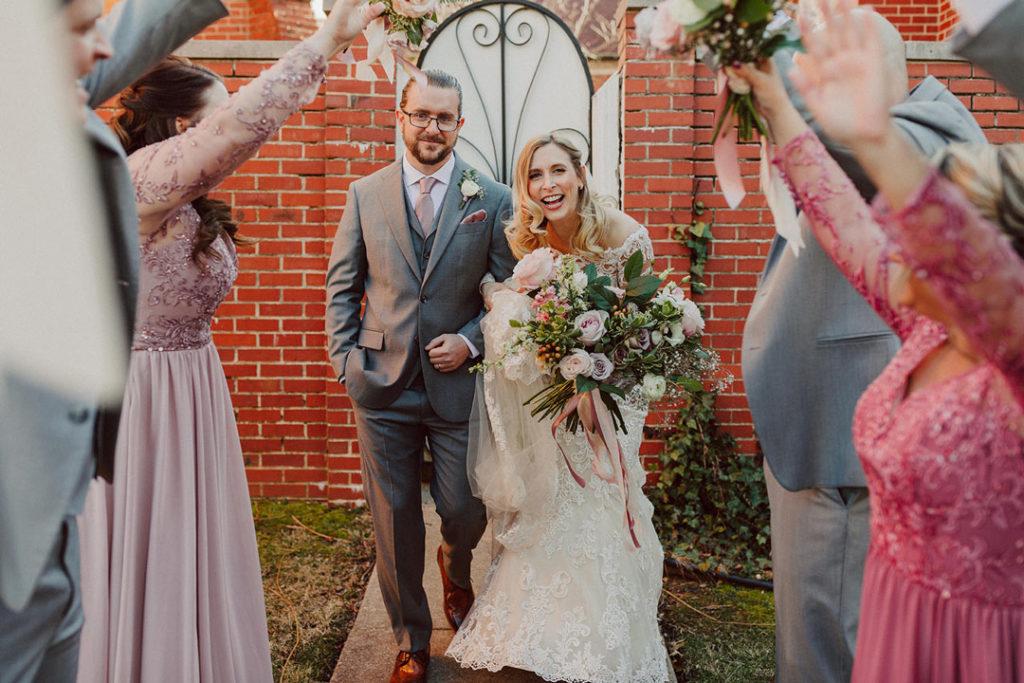 Joyful newlywed exit