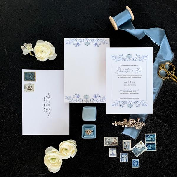 Blue wedding invitation flatlay