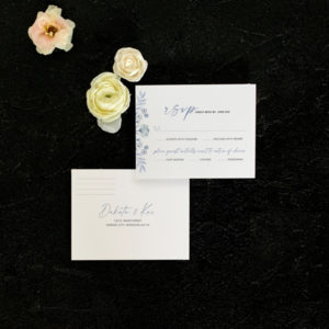 Rose reply card flat lay in blue