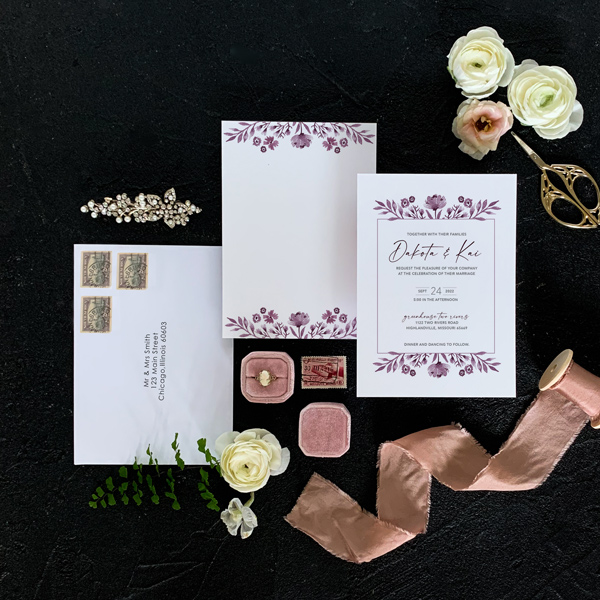 Rose invitation flat lay in burgundy