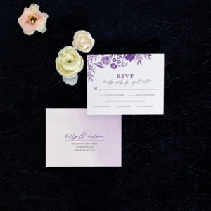 Daisy reply card flat lay in plum