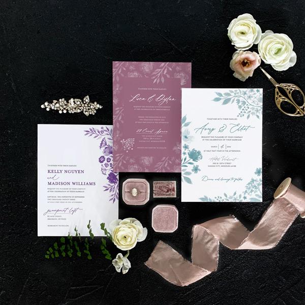 Flat lay of 3 different wedding invitation designs
