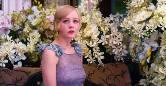 Carey Mulligan as Daisy Buchanan surrounded in flowers