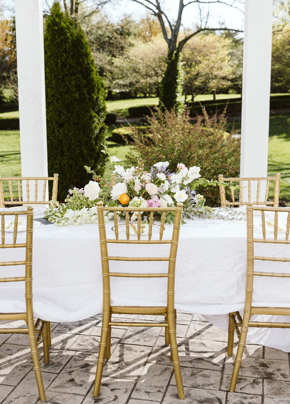 Spring centerpiece sitting on wedding guest table