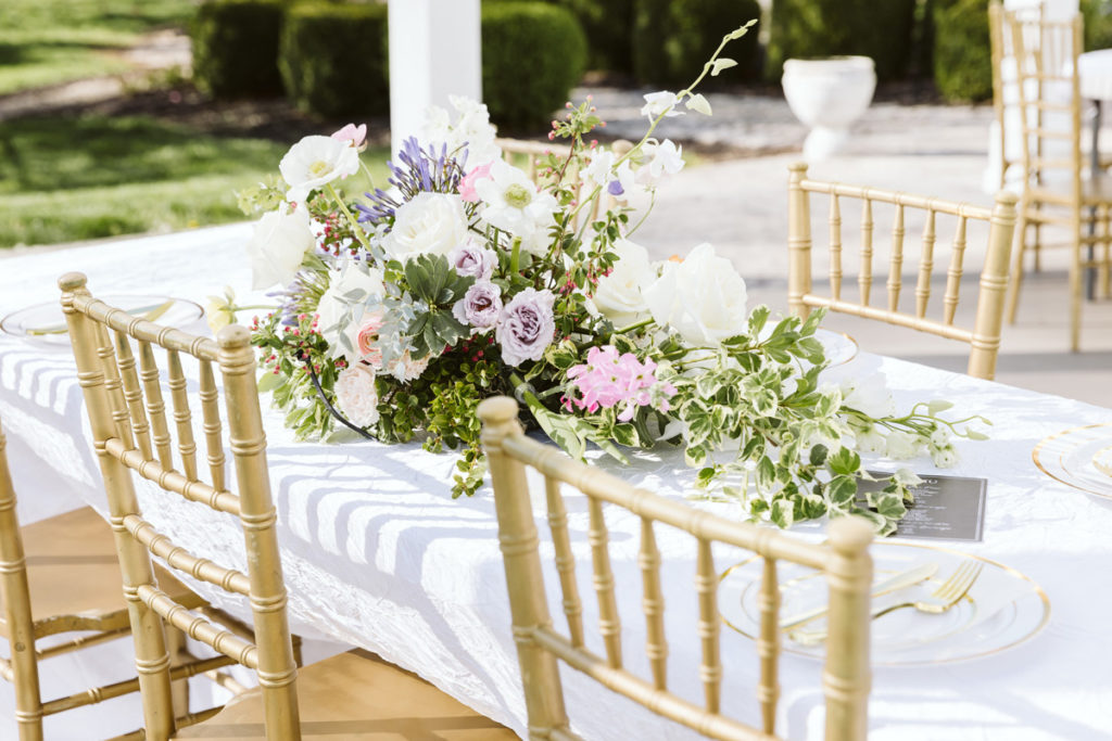Wide floral centerpiece on guest table